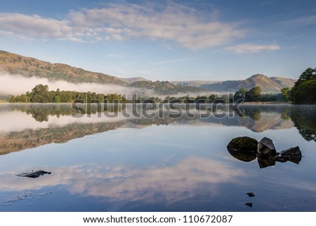 Grasmere and Helm Crag (the Lion and the Lamb) at first light on a misty morning