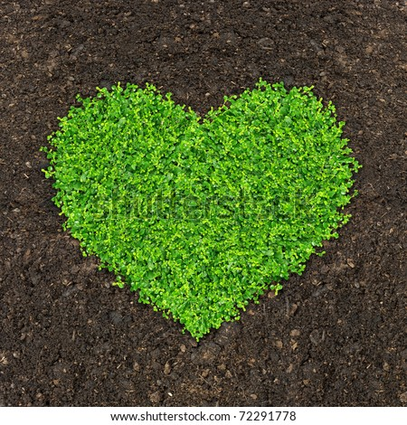 Grass and green plants growing a heart shape on soil for Soil and green