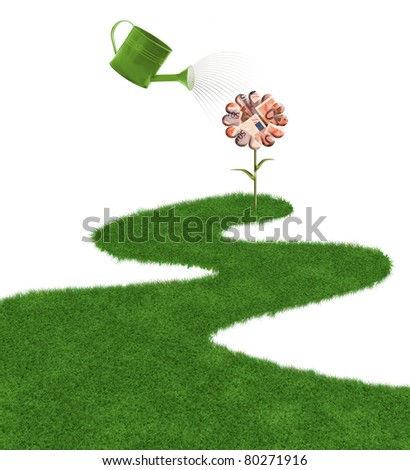 grass and watering can -road to money - stock photo