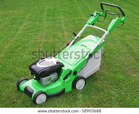 grass cutter on a meadow