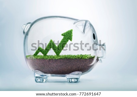 Grass growing in the shape of an arrow graph, inside a transparent piggy bank, symbolising the care, dedication and investment needed for progress, success and profit in business. #772691647