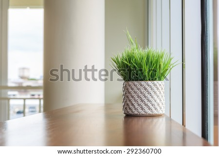 Grass in vase on wood table in the cozy room