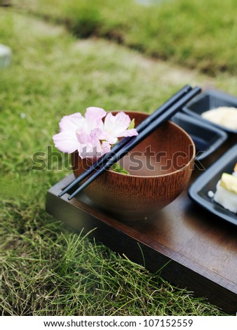 Grass on a table set with sushi.