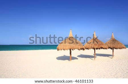 Grass umbrellas at a beach resort