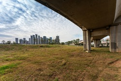 Grass under the overpass,Freeway, overpass and junction with green grass