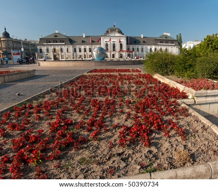 Grassalkovichov palace. red flowers in foreground, nice sunny day, square composition