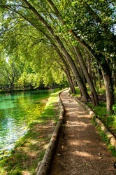 grassano park in campania with a view of the river and the greenery.