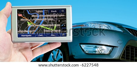 Grate car isolated on blue. gps in a man hand