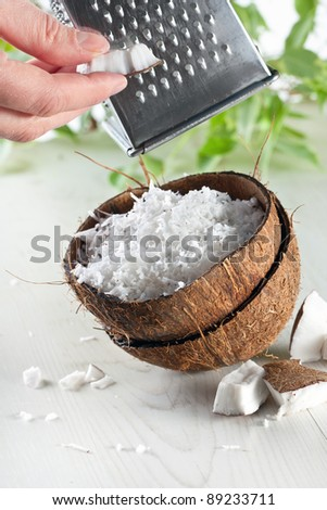 grate coconut with grater and nut