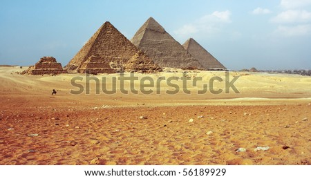 Grate Giza pyramids and blue sky with clouds.