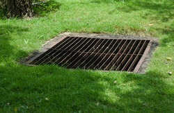Grate off the drain on the lawn.