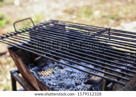 Grate placed on the grill, grill #1579512328
