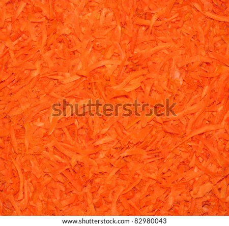 Grated carrots background. Close-up.