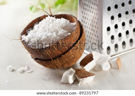 grated coconut with grater and nut