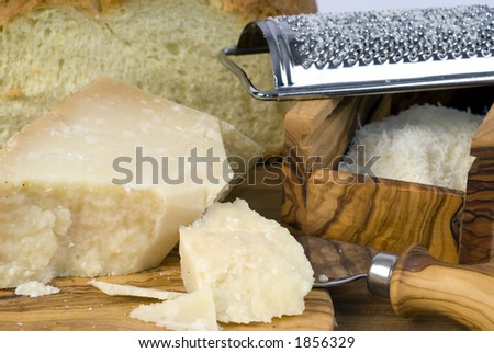 Grated Grana Padano and cut bread on a table #1856329