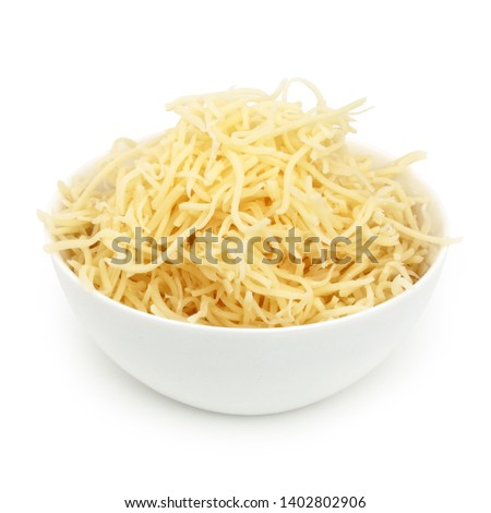 Grated Gruyere or grated Emmental cheese in a cup isolated on white