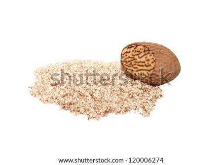 Grated nutmeg and whole nutmeg with grated face, isolated on a white background