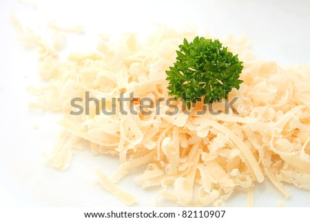 Grated of traditional parmesan cheese isolated on white