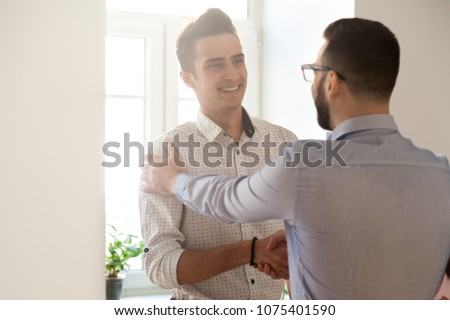 Grateful boss handshaking employee congratulating with job promotion, appreciating good results, friendly ceo proud of subordinate shaking hand expressing gratitude, recognition, support and respect