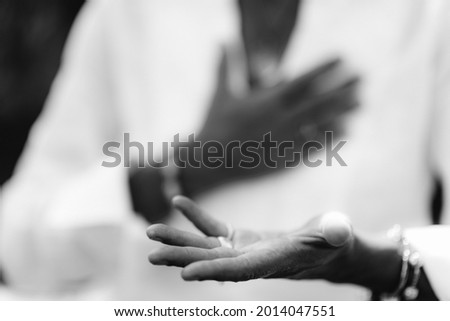 Gratefulness – Woman expressing gratitude with hands. Close up image of female hands in prayer position outdoor. Self-care practice for wellbeing Foto stock ©