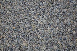 grating on ground holding multiple shade of grey gravel. covering dirt with porous paving material good for walk and water seepage. environmental friendly and creative landscape garden outdoor space.