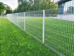 grating wire industrial fence panels, pvc metal fence panel and neatly trimmed lawn.