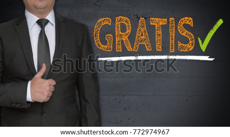 Shutterstock Gratis ( in german free of charge) concept and businessman with thumbs up.