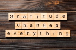 Gratitude changes everything word written on wood block. Gratitude changes everything text on wooden table for your desing, concept.