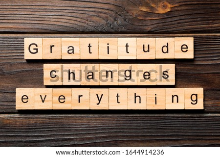 Gratitude changes everything word written on wood block. Gratitude changes everything text on wooden table for your desing, concept. Stockfoto ©