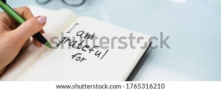 Gratitude Journal Concept. Writing I Am Grateful In Journal Stockfoto ©