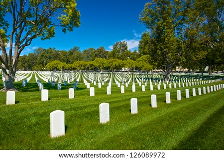 Grave stone head markers lie in patterns across the grounds of the Los Angeles National Cemetery.