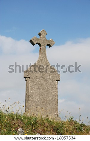 grave with celtic tombstone