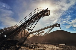 Gravel Crusher on the sun and the sky. Beautiful light. Extraction of gravel.