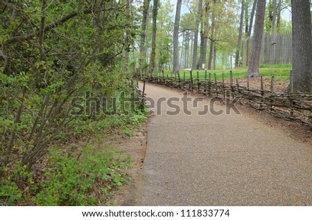 gravel path with stick fence
