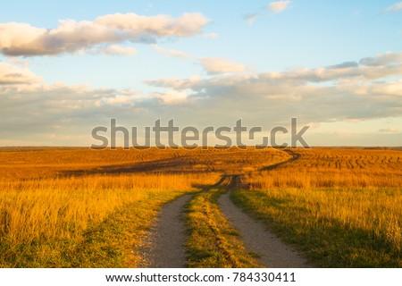 Photo of  Gravel pathway on Wah'Kon-Tah Prairie towards sunset