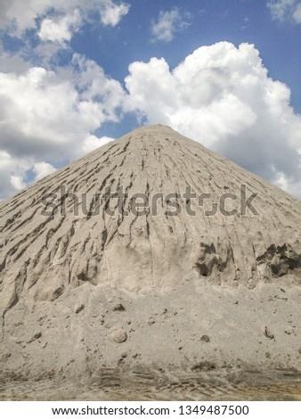 Gravel pile with clouds