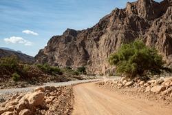 Gravel road and landscape in Oman's Wadi Arbiyeen