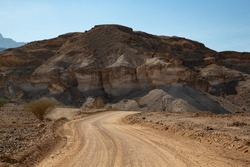 Gravel road and mountain landscape in Oman