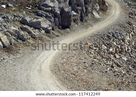 Gravel Road in mountains - as the background or texture