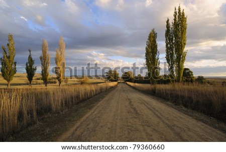 gravel road in rural south africa, on the road to rustler's valley, Ficksburg, free state, south africa - stock photo