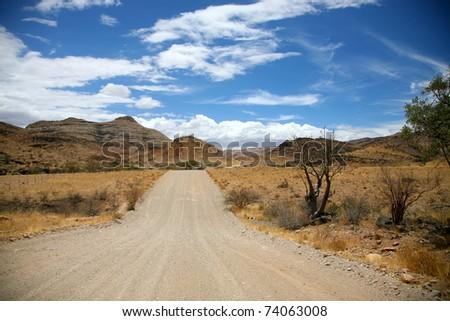 Gravel road in the region of Brandberg in Namibia