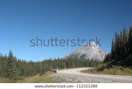 Gravel Road leading into the mountains.  Spray Lakes Road looking north, Kananaskis Country, Alberta Canada