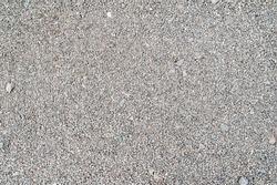 Gravel texture. Fine light gray stone gravel. Natural textural background.
