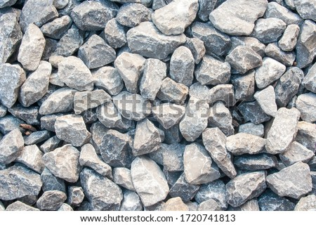 Photo of  Gravel texture. Pebble stone background. Light grey closeup small rocks. Top view of ground gravel road.