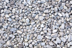 Gravel texture. Small stones, little rocks, pebbles in many shades of grey, white and blue. Texture of little rocks