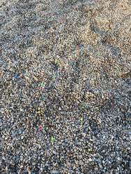 Gravel with confetti on playground in Prague