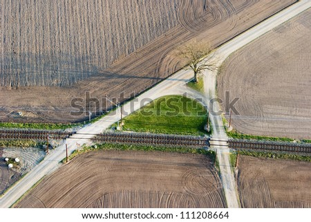 Graveled roads in agricultural district and a railway