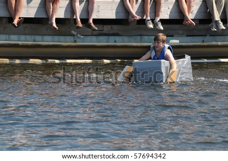 GRAVENHURST, ONTARIO, CANADA - JULY 10: Young participant in the Cardboard boat race during the annual Clssic Boat Show July 10, 2010 in Gravenhurst,Ontario,Canada