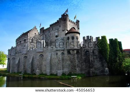 Gravensteen castle reflecting in the river. Gent, Belgium
