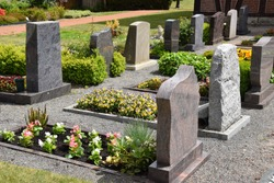 Graves in a well-kept village cemetery